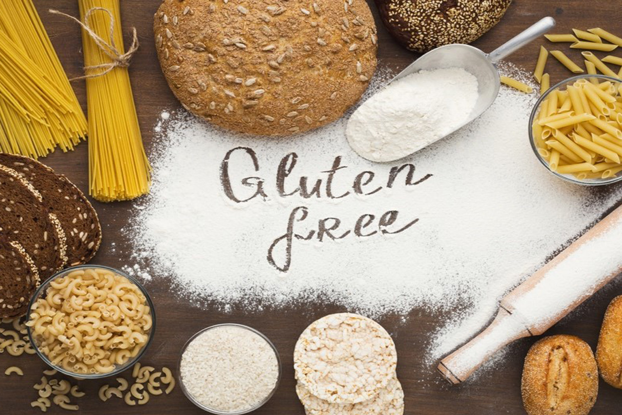 """Picture of many different types of gluten free food with """"Gluten free"""" written in the middle"""