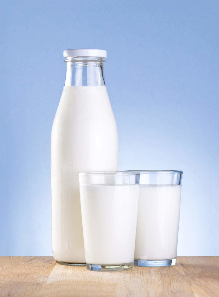 Picture of a bottle and 2 cups of diary milk