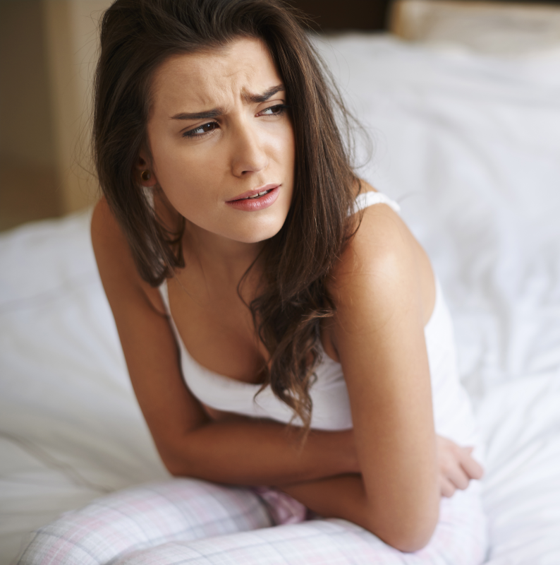 Picture of a lady experiencing upper abdomen discomfort