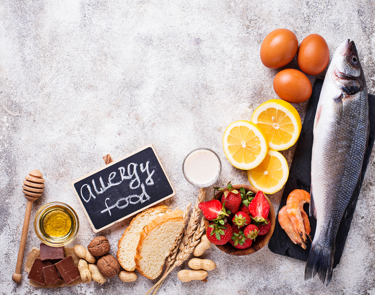 """Picture of different type of food with a board that have """"Allergy food"""" written on it"""