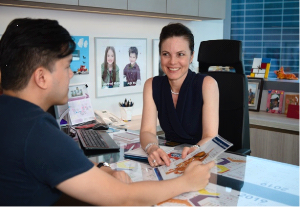Dr. Andrea Rajnakova of Andrea's Digestive Clinic Singapore consulting a patient