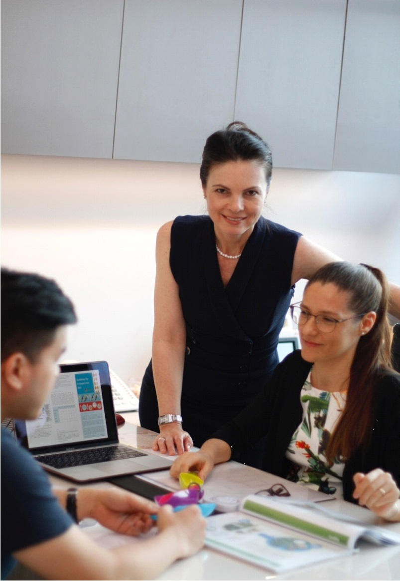 Dr. Andrea Rajnakova and Ms. Veronica Cavallini of Andrea's Digestive Clinic Singapore consulting a patient