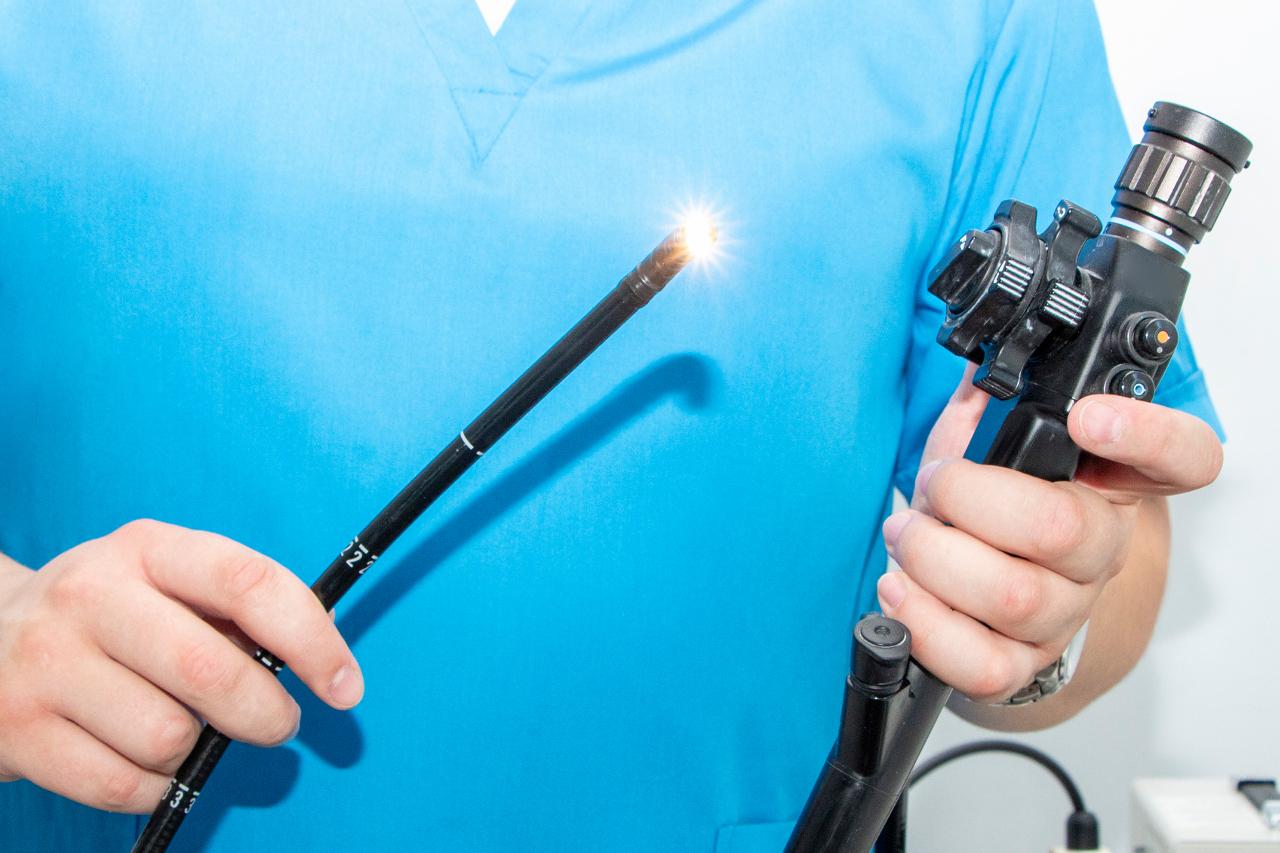 doctor holding gastroscope